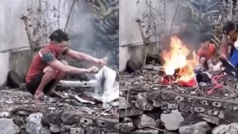 Clip sôi máu: Người đàn ông mang quần áo, sách vở của con ra đốt, chửi cả bố đẻ