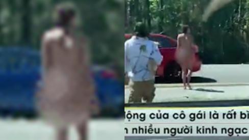 Cô gái khỏa thân bình tĩnh băng qua đường cao tốc