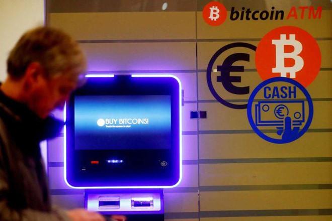 Tiền ảo Bitcoin tiếp tục tăng giá mạnh, vượt mốc 7.000 USD-1