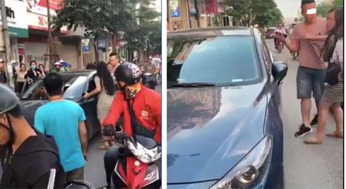 Hà Nội: Bắt quả tang chồng dẫn bồ đi nhà nghỉ, vợ mang bầu xông vào giằng co ngay giữa phố