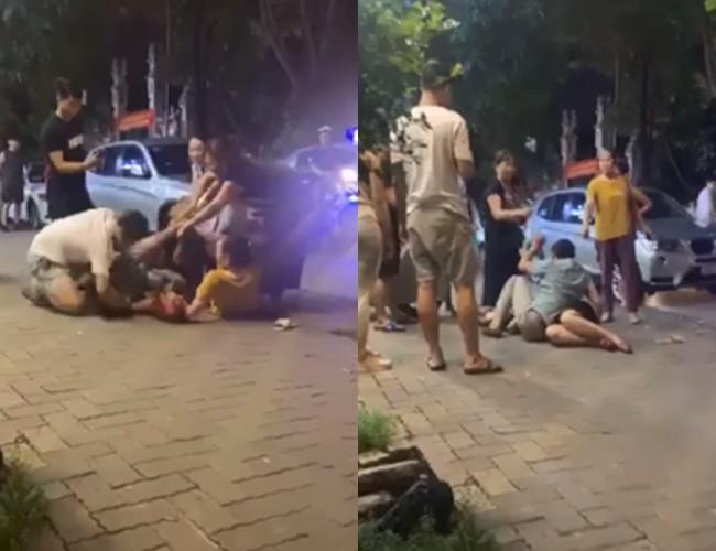 Bị vợ con lao vào đánh ghen, người đàn ông liên tục che chắn cho nhân tình rồi cầu xin: Thôi bố về, bố xin lỗi tất cả mọi người-1