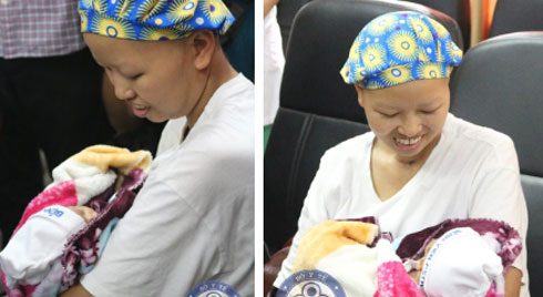 Bé Đỗ Bình An - con của sản phụ ung thư vú giai đoạn cuối Nguyễn Thị Liên - được xuất viện về với gia đình