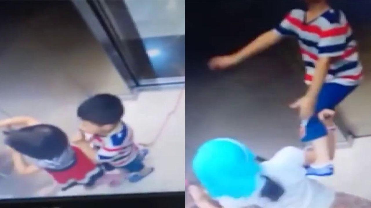 Bé trai mang dây thừng đi chơi bị treo cổ trong thang máy