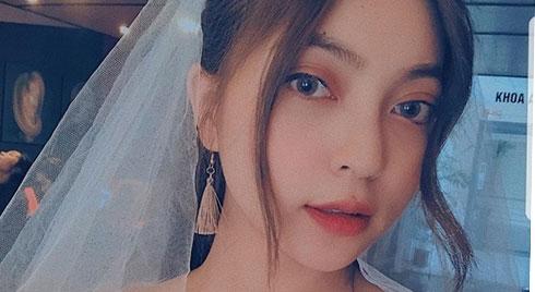 Giữa ồn ào tình cảm, Quang Hải đăng trạng thái buồn, Nhật Lê mặc áo cưới