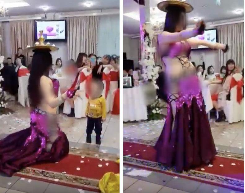 Hình ảnh hai cô gái ăn mặc hở hang vô tư uốn éo, múa bụng trước mặt trẻ con trong đám cưới gây xôn xao-1