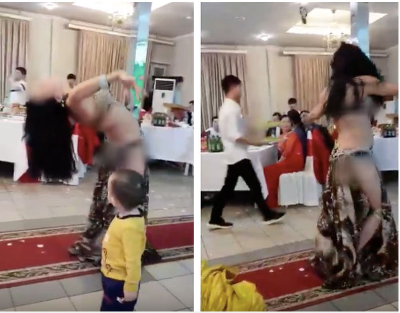 Hình ảnh hai cô gái ăn mặc hở hang vô tư uốn éo, múa bụng trước mặt trẻ con trong đám cưới gây xôn xao-2