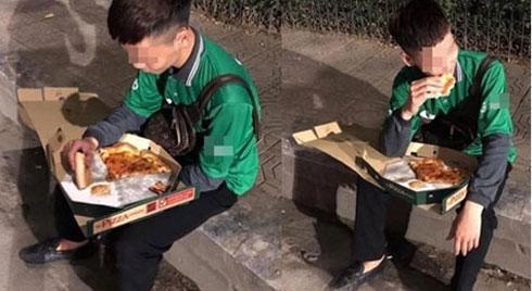 Cuối năm, hình ảnh shipper ngồi vỉa hè, ăn miếng pizza trong cay đắng khiến tất cả bức xúc