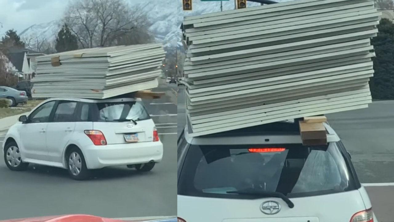 """Xế hộp """"làm xiếc"""" chở vật liệu cồng kềnh trên nóc xe chạy bon bon"""