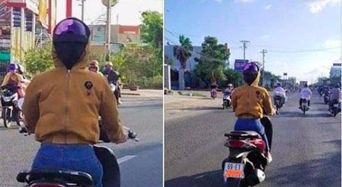 Người phụ nữ ở Cà Mau đi xe máy nhưng đội mũ bảo hiểm ngược và trùm áo kín mặt