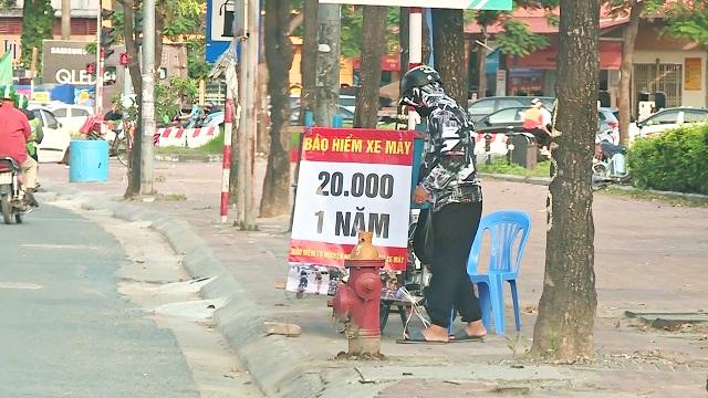 Theo chân PV đi mua bảo hiểm xe máy giá 20 nghìn đồng một năm