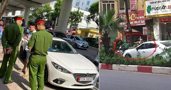 Hà Nội: Tài xế ô tô hất văng cảnh sát lên nắp capo khi bị kiểm tra vì dừng đỗ trên vỉa hè