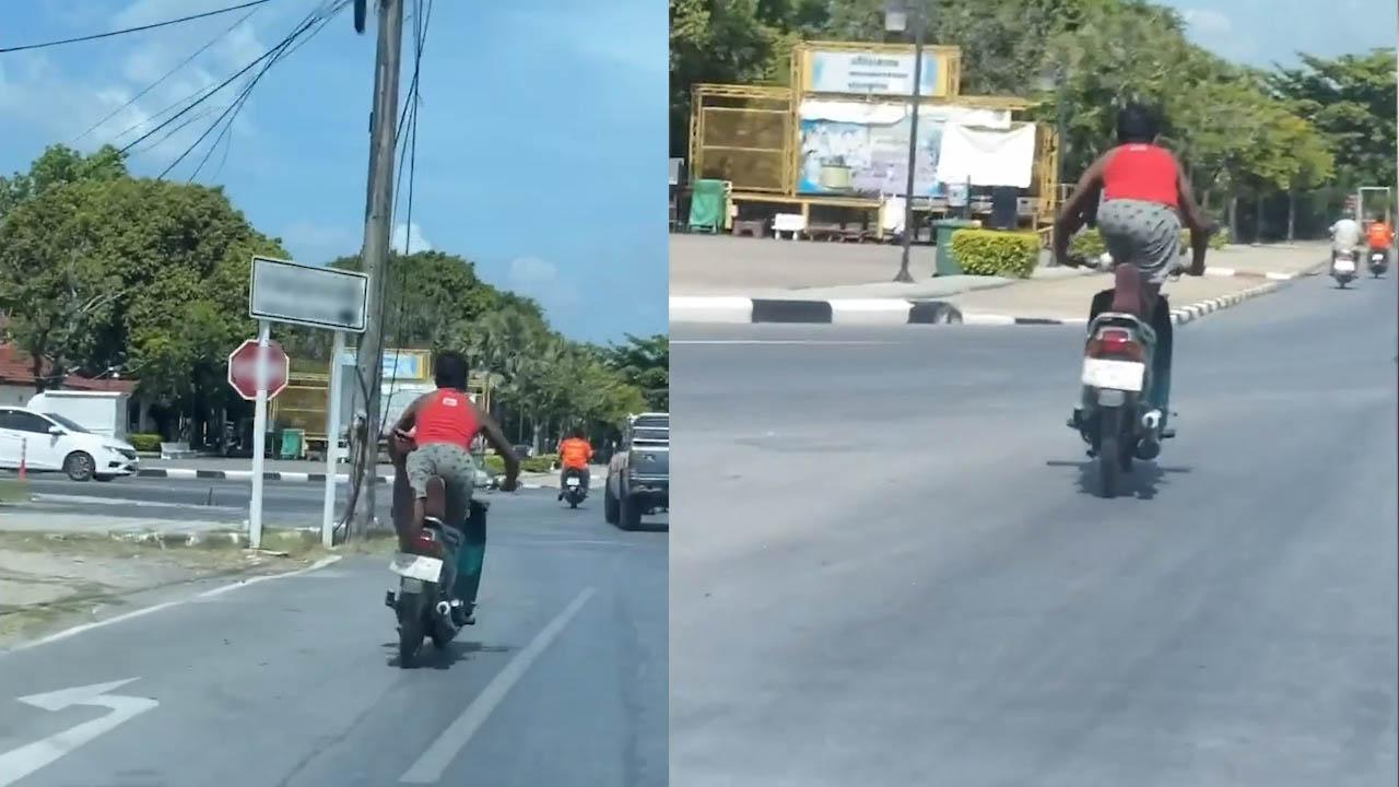 Nam thanh niên 'tập thể dục' trên yên xe máy giữa phố