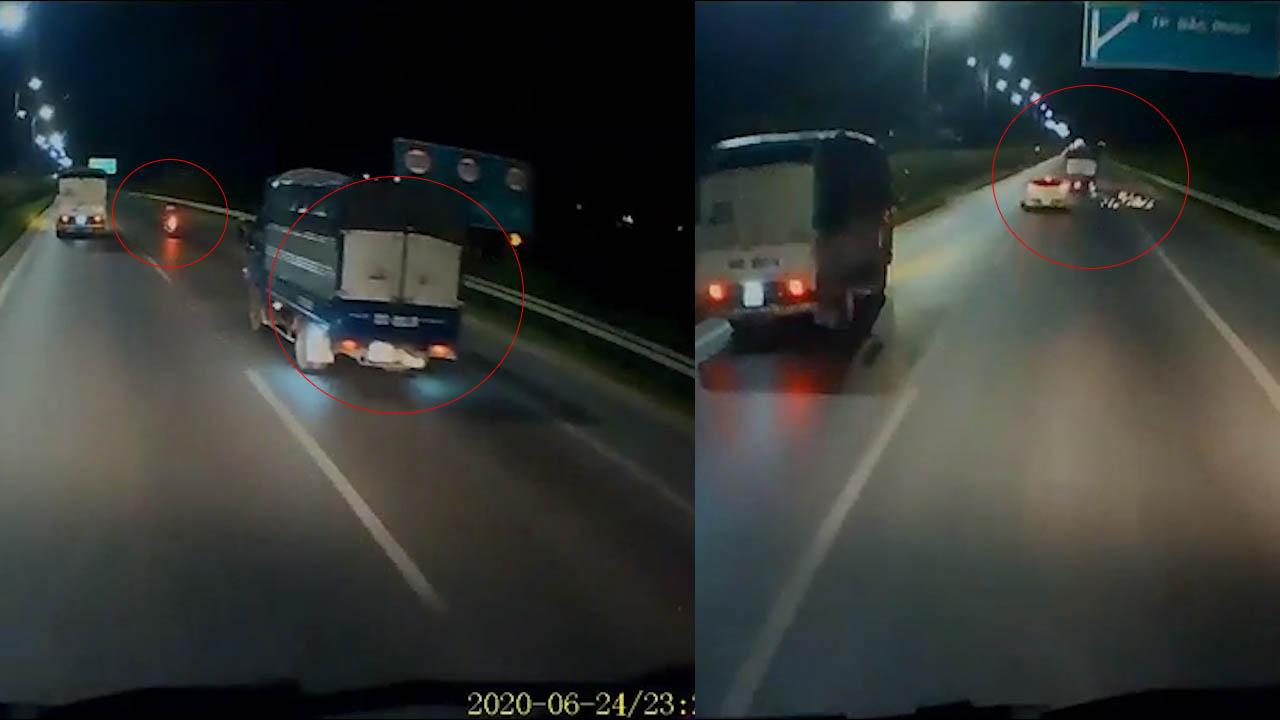 Xe tải chuyển làn bất ngờ, húc bay xe máy rồi bỏ chạy