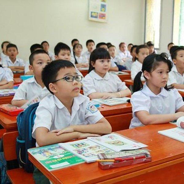 Từ nay, học sinh tiểu học không phải đóng học phí