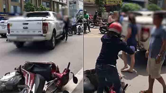 Bị vợ chặn xe bán tải đánh ghen, chồng lao xuống can ngăn để bồ xách guốc bỏ chạy
