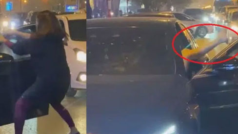 Người phụ nữ chặn xe Mercedes giữa đường phố Hà Nội nghi do bị
