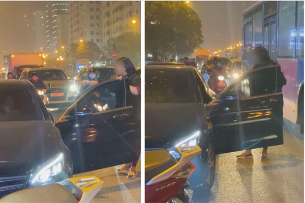 Người phụ nữ chặn xe Mercedes giữa đường phố Hà Nội nghi do bị bạn tốt cướp chồng, cú đá của cô gái trẻ từ ô tô gây chú ý-1