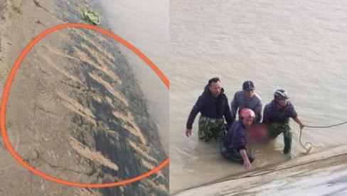 Xót lòng nhìn những vết cào trên bờ đê của cậu bé 9 tuổi bị đuối nước