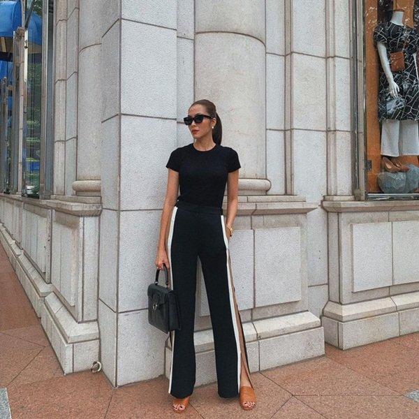 Diện quần đen sẽ giúp chân nhỏ hẳn đi nhưng để trông thật sành điệu chứ không nhàm, chị em hãy học Hà Tăng-6