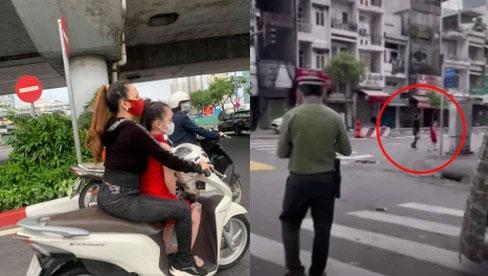 """""""Chị đại quận 4"""" lại tái xuất: Vẫn không đeo khẩu trang, dẫn con gái đi lang thang trên phố trong ngày đầu TP.HCM siết chặt giãn cách"""