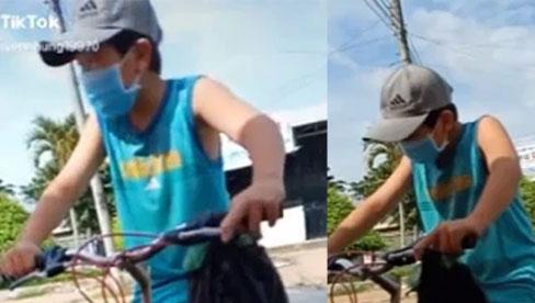 Cậu bé đạp xe xin qua chốt để đưa đồ cho ngoại, khi được hỏi
