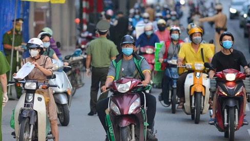 Hà Nội cho phép người dân tiếp tục sử dụng giấy đi đường mẫu cũ