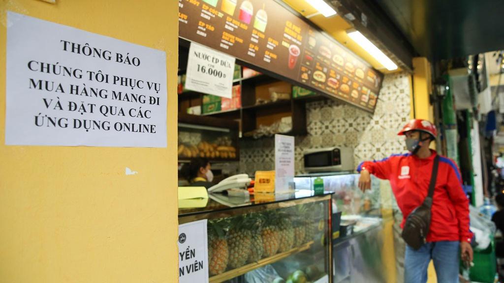 Từ 12 giờ 16.9, Hà Nội cho phép bán hàng ăn mang về, mở văn phòng phẩm-1