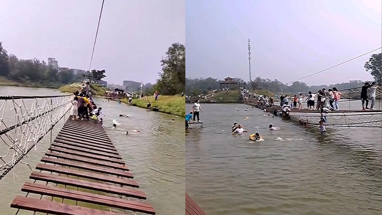 Cầu treo bất ngờ đứt khiến hàng chục du khách Trung Quốc rơi xuống sông
